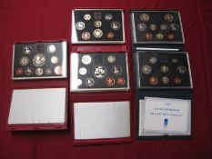 Five Royal Mint United Kingdom Proof Coin Collections, 1986, 1989, 1990, 1996, 1998, both red and