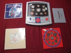 Four Royal Mint United Kingdom BU and Proof Coin Sets, comprising 1984 (BU), 1986 (BU), 1997 (BU),