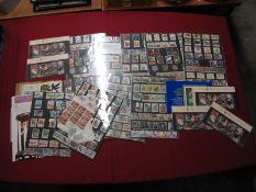 A Collection of GB Decimal Stamps, in year packs, presentation packs and loose with a face value