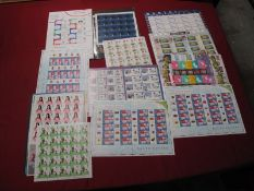 A Collection of GB Mint Stamps, in sheets, parts sheets with a face value of over £230.