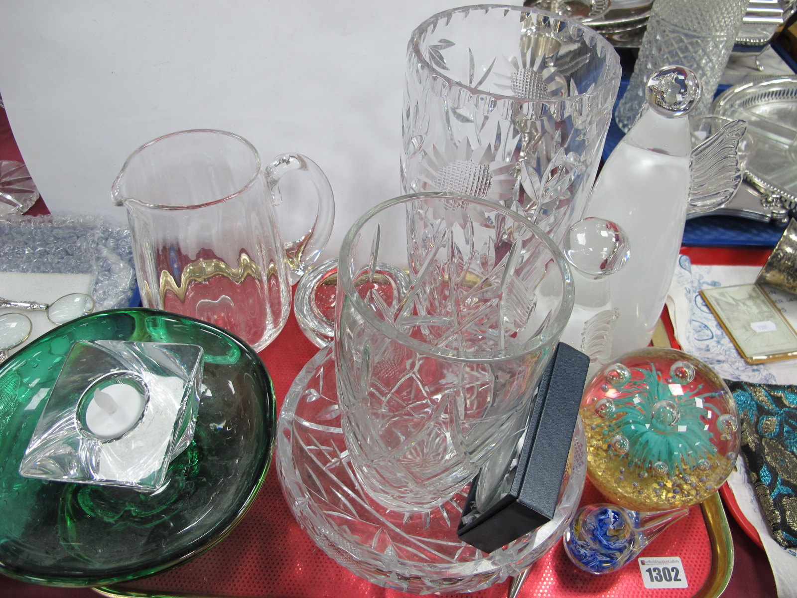 Lot 1302 - A Green Glass Fruit Bowl, having bubble inclusions Orrefors candlestick, other glassware:- One Tray