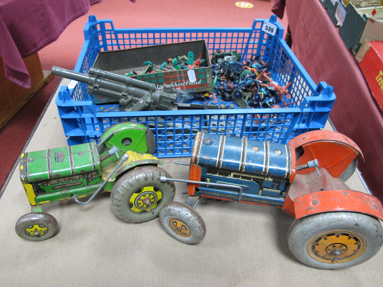 Lot 539 - Two 1950's Tinplate Tractors, by Mettoy, a Marx plastic cannon and a quantity of Mid XX Century