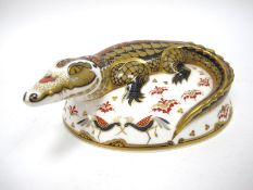 A Royal Crown Derby Paperweight 'Crocodile', gold stopper, date code for 2004, 16.5cm long.