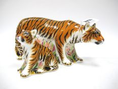 A Royal Crown Derby Paperweight 'Sumatran Tigress', gold stopper, date code for 2009, 19cm high;