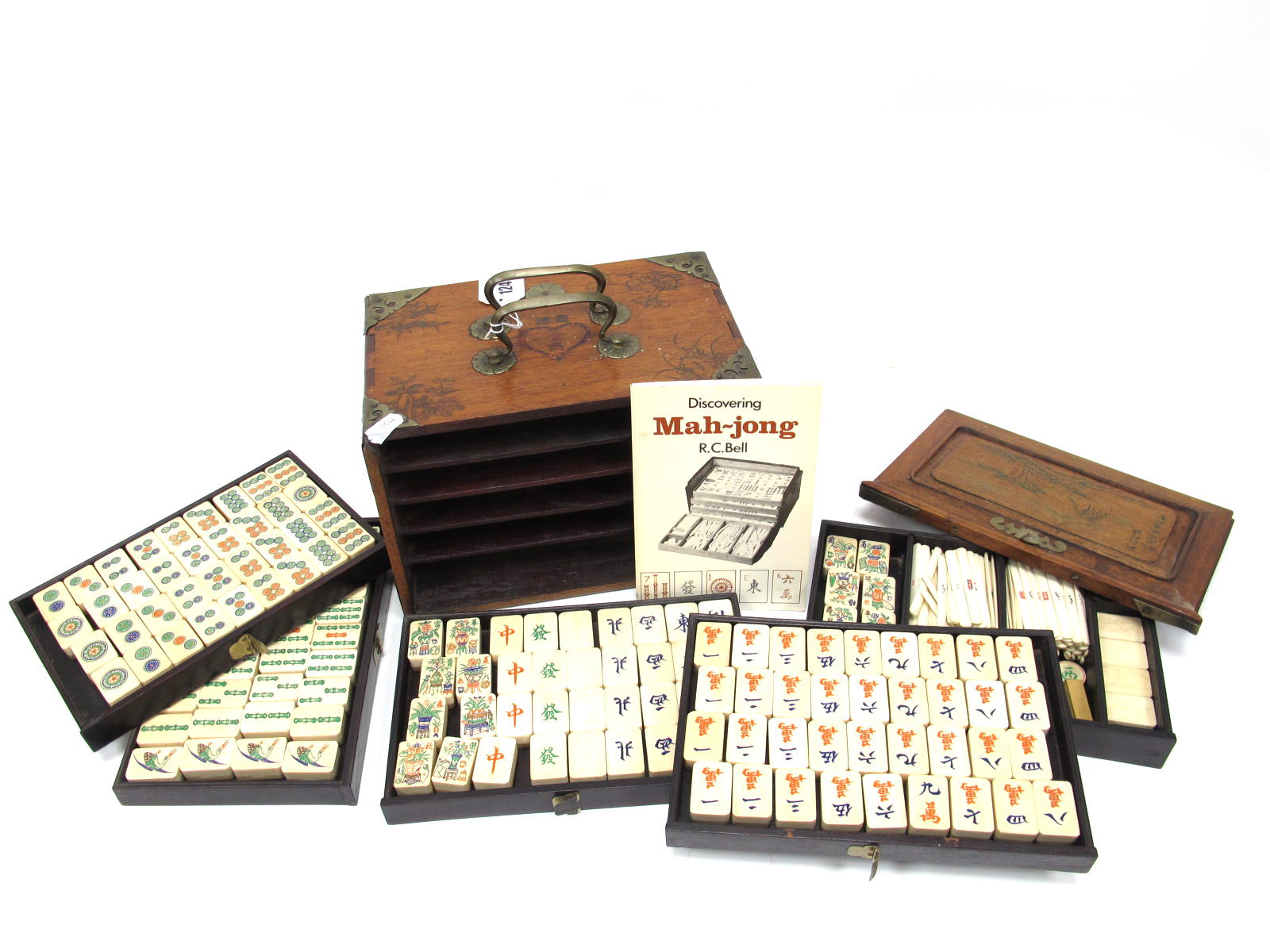 An Early XX Century Mah-Jong Set, contained in a five drawer hardwood carry case decorated with