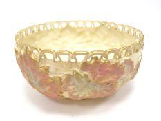 A Royal Worcester Porcelain Circular Bowl, with a pierced rim, blush ivory basket work, ground