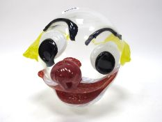 John Ditchfield for Glasform; A Clear Glass Clown's Head, with applied features and bright yellow