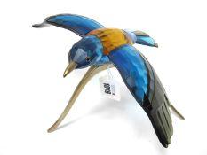 A Swarovski Crystal Paradise Bird Sculpture 'Roller Bird', on metal stand, 25cm wide.