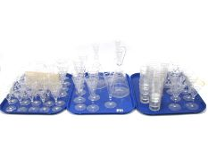 A Late XIX Century Table Suite of Glassware, each piece finely etched with trailing flowering