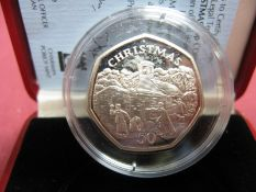 A Pobjoy Mint Isle of Man Silver Proof Christmas Fifty Pence Coin 1996 'Choirboys Snowball Fight',