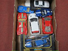 A Quantity of 1/18 and 1/24 Scale Diecast Vehicles by Burago and Others, one boxed, some damages