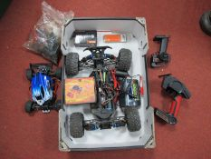 A Quantity of Remote Control Car Spares, including two chassis/motors/suspension components,
