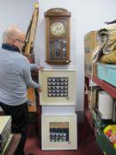 An Oak Regulator Wall Clock, two butterfly model montages by Sue Gorman.