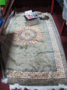 WITHDRAWN Silk Style Tasseled Rug, with symmetrical design on green ground, approximately 225 x 146