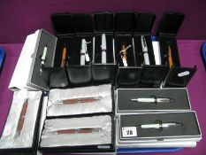 Twelve Modern Vicci Ball Point Pens, including with shell inlay (price tag noticed £31.25), all