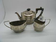 A Hallmarked Silver Three Piece Bachelor's Tea Set, (marks completely rubbed) of oval semi reeded