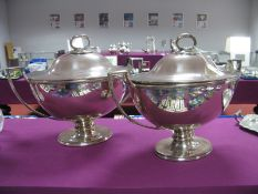 A Pair of Elkington & Co Plated Soup Tureens, each of plain oval form with twin angular loop