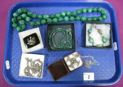 A Chunky Single Strand Polished Green Hardstone Bead Necklace, of uniform design, knotted, overall