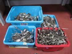 A Quantity of Various Plated Spoons, forks sugar tongs, ladles, etc, in four small storage boxes.