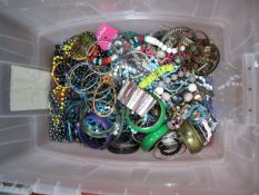 A Large Mixed Lot of Assorted Costume Jewellery, including beads, bangles etc:- One Box