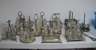 A Large Collection of Assorted Plated Condiment Stands, some fitted/part fitted with glass bottles/