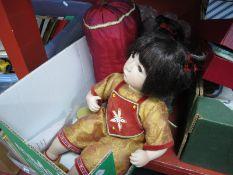 A Modern Alberon Ceramic Doll, with cushion, 44cm high.
