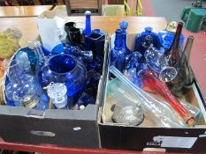 An Assortment of Blue Glassware, including oil lamp, decanters, vases etc:- Two Boxes