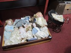 Eight Modern Porcelain Collectors Dolls; plus a small porcelain doll in antique style pushchair. (