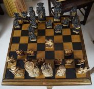 CHESS TABLE AND 30 ANIMALIA AND FIGURAL PIECES