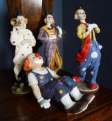 GROUP OF FOUR CLOWN FIGURINES