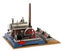 Dampfmaschine Wilesco, D20, vernickelter Messingkessel, liegend auf Sockel in Maueroptik,