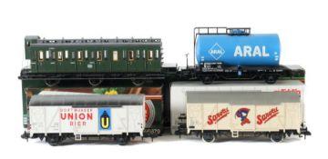 "4 Wagen Märklin, Spur 1, 1 x Personenwagen 5804 im OK; 1 x Tankwagen ""Aral"" 587; 1 x Kühlwagen """