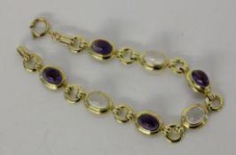ARMBANDSilber vergoldet mit Amethysten und Mondsteinen. L.19cmA BRACELET Silver, gold-plated with