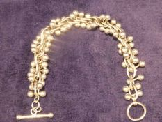 A Tiffany and Co 925 silver Bracelet, twist link form with strands of beads, Albert style