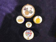 Five enamel and gilt and metal pill boxes, all with ballooning theme, one by Royal Worcester and