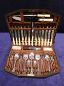 A good quality mid 20th century oak cased sixty-seven piece Canteen of Cutlery by John Barker of