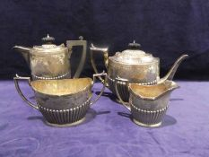 A late 19th century four piece silver Tea Service, oval form, ribbed sides, hinged lids to teapot