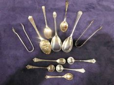 A selection of silver small work, ten small spoons and two pairs of sugar nips, 5.51oz (12)