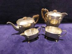 A mid 20th century Art Deco style silver four-piece Tea Service, rounded rectangular form, hinged
