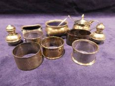 Twelve items of small silver tableware, five odd napkin rings pair of small salt and pepperette, two