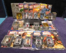 An extensive collection of Marvel Eagle Moss Superhero Magazines and lead figures comprising: issues