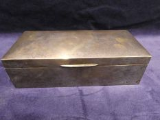 An early 20th century silver cased Cigarette Box, rectangular with hinged dome top lid wood