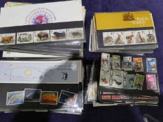 A box of first day covers and loose GB stamps