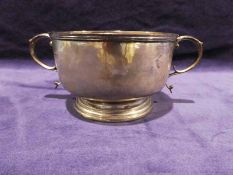 An Edwardian silver two-handled Porringer, circular with reeded rim on stepped circular foot with