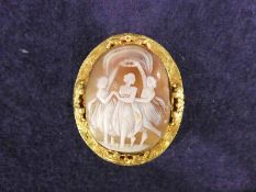 A Shell cameo brooch set in gilt metal decorated with engraving and applied decoration