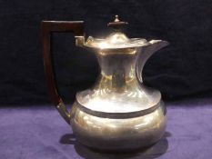 An early 20th century silver Teapot, rounded rectangular form with elongated neck, hinged,