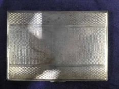 A mid 20th century silver Cigarette Case, rectangular with engine turned surfaces, both internally
