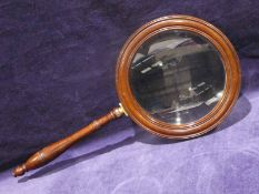 A 19th century mahogany framed Gallery Glass, moulded frame, ring turned handle and brass mount,