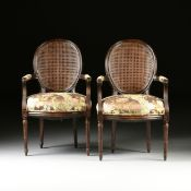 A PAIR OF LOUIS XVI STYLE CANE BACK AND UPHOLSTERED STAINED WOOD FAUTEUILS, 20TH CENTURY, each