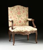 A RÉGENCE STYLE UPHOLSTERED AND CARVED OAK HIGH BACK FAUTEUIL, LATE 19TH CENTURY, with a tall